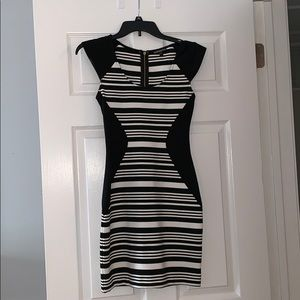 Black and white striped, form-fitting dress.